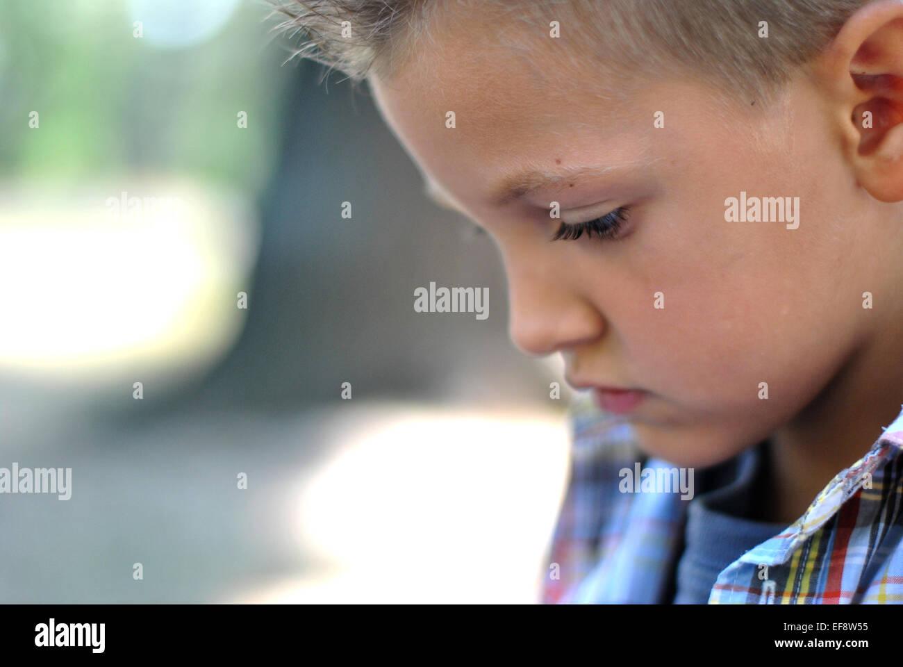 Headshot of young boy (6-7) - Stock Image