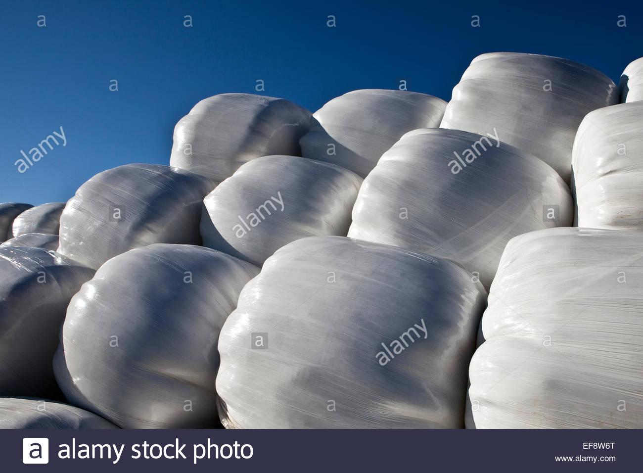 Iceland, Whalefjord, Pile of white sacks against blue sky - Stock Image
