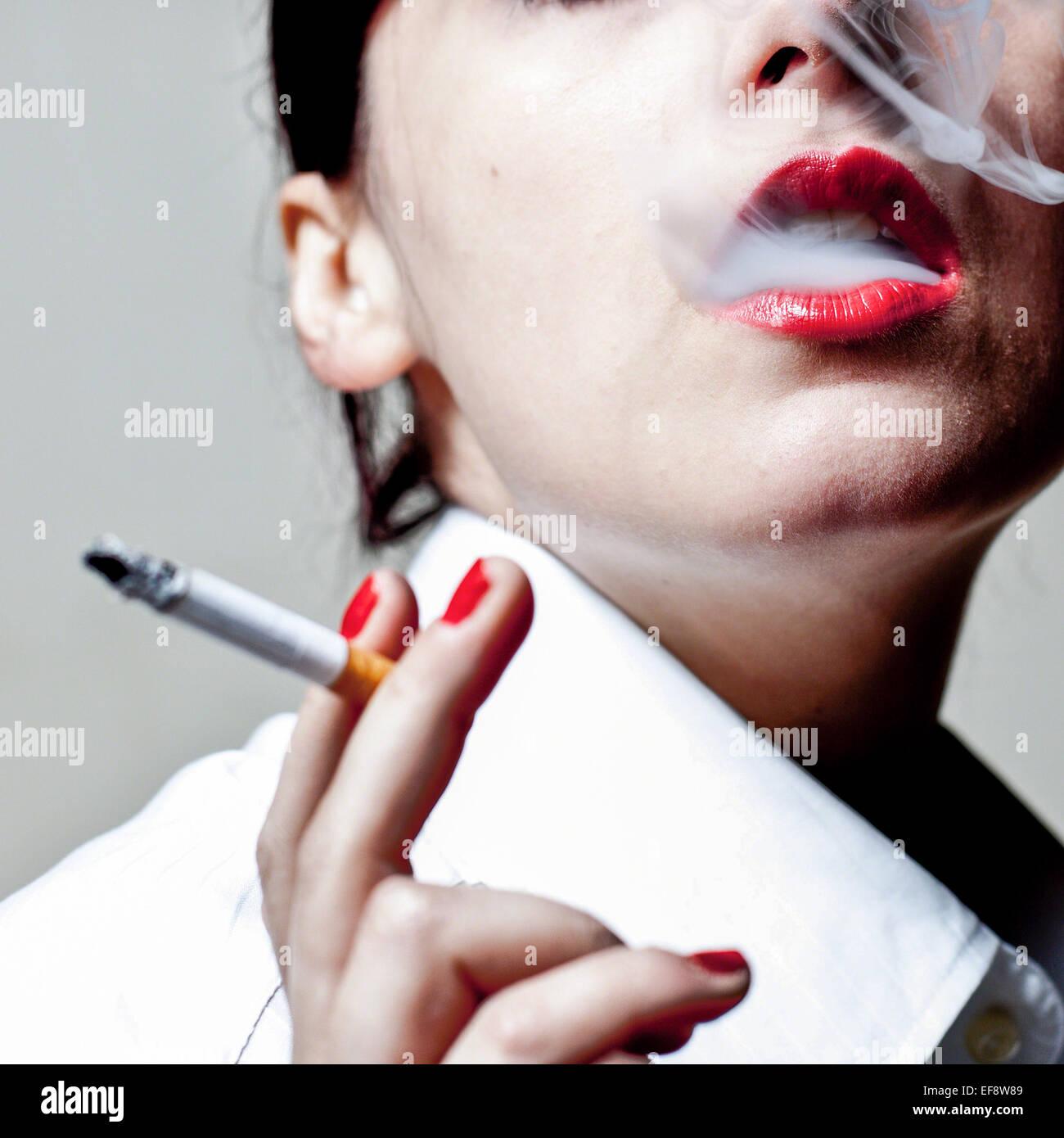 Woman smoking cigarette - Stock Image