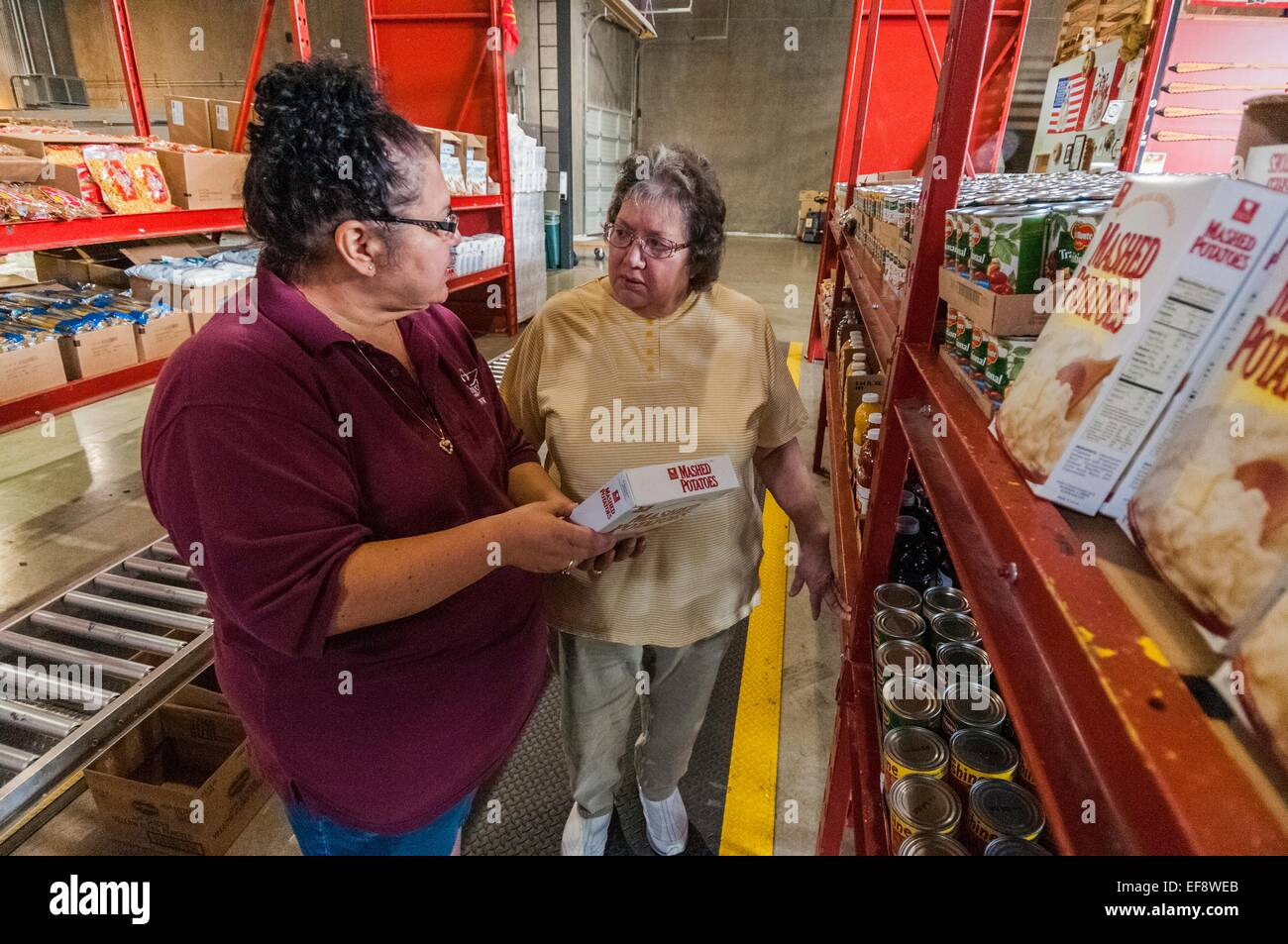 Employees of the Food Distribution Program on Indian Reservations fills requests at the food distribution center - Stock Image