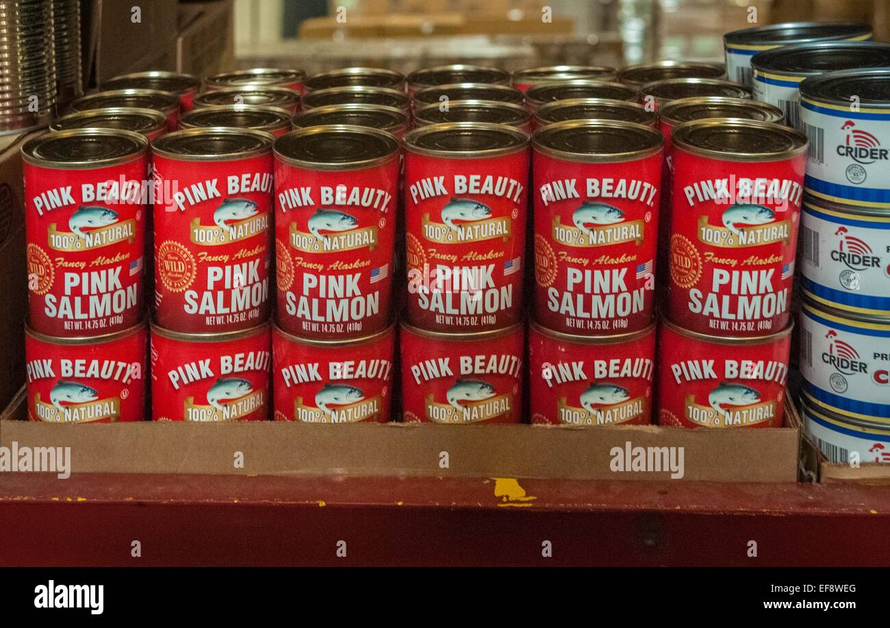 Canned salmon on the shelves of the Food Distribution Program on Indian Reservations distribution center in South - Stock Image