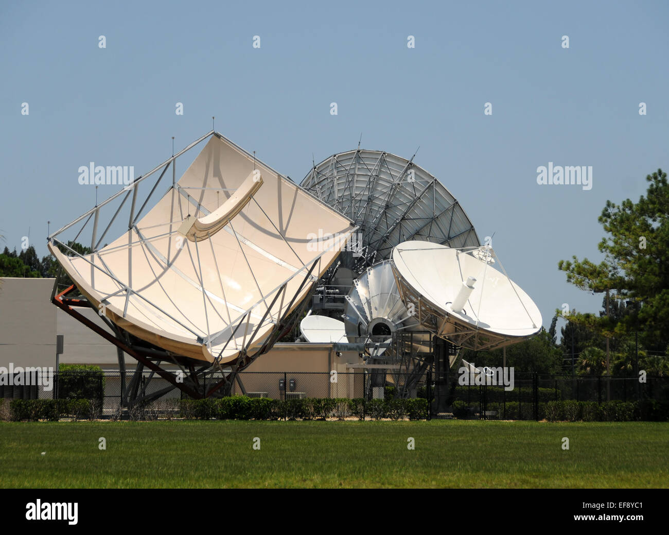 Array of giant satellite antennas pointing in the sky Stock Photo