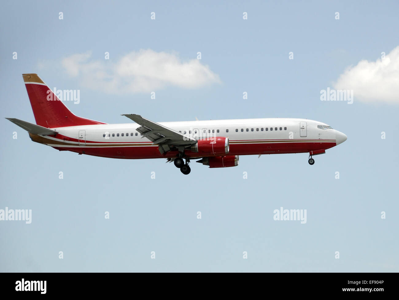 Side view of jet airplane landing Boeing 737 - Stock Image