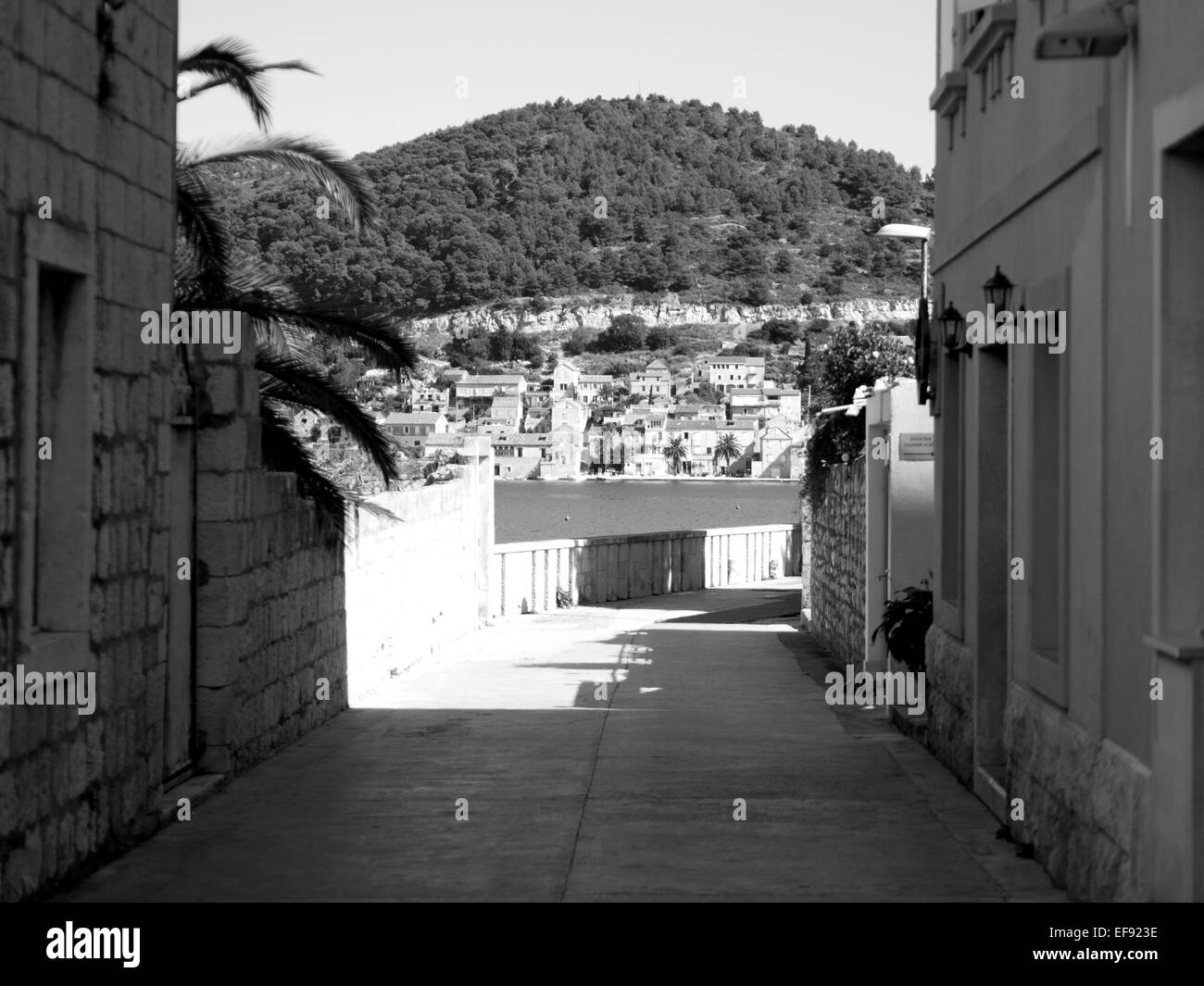 Empty street on island Vis with stone buildings in black and white - Stock Image