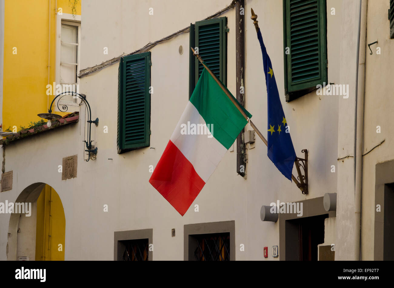 Italian and European Union flags on a building in Lucca, Tuscany, Italy - Stock Image