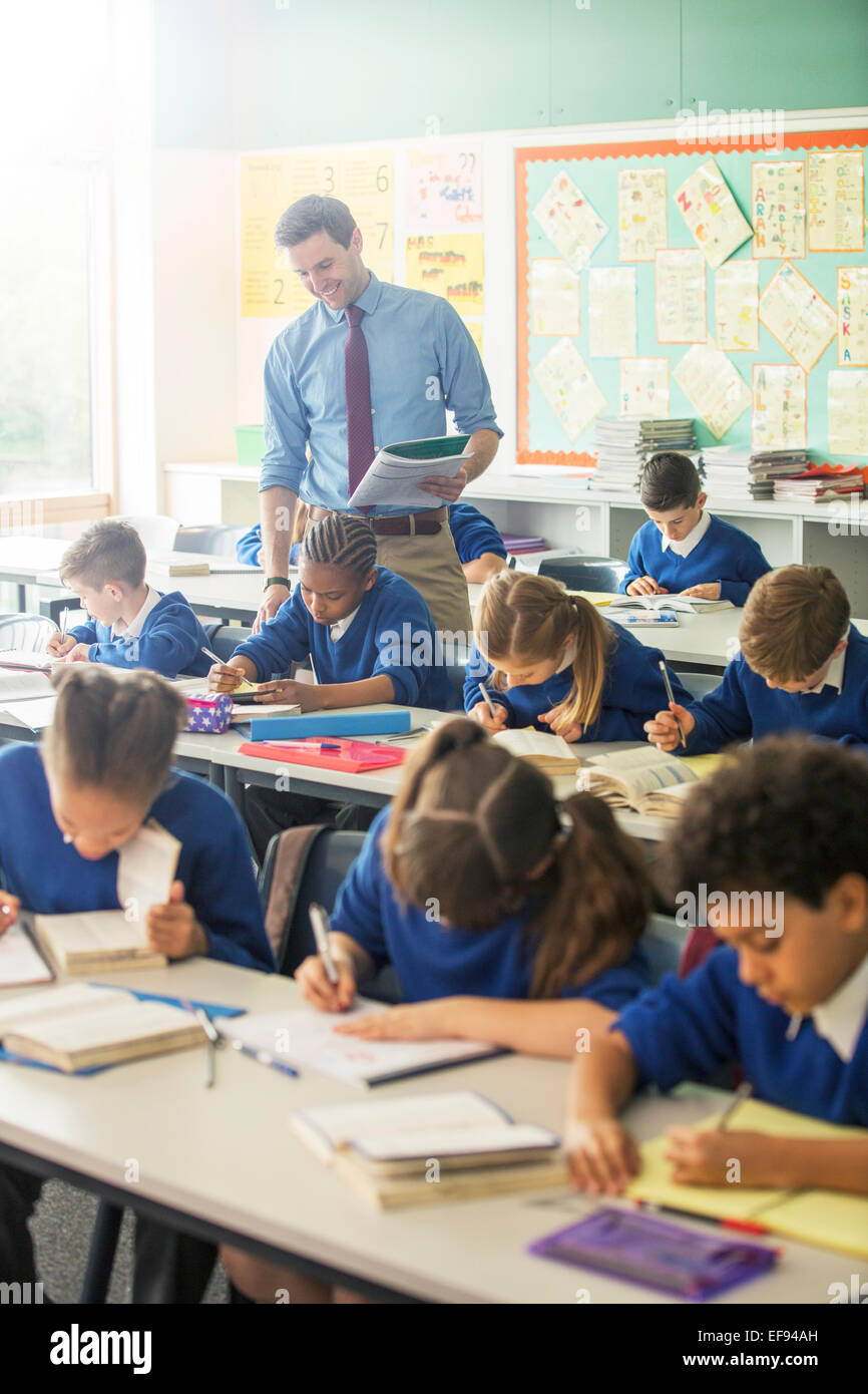 Elementary school children in classroom during lesson - Stock Image