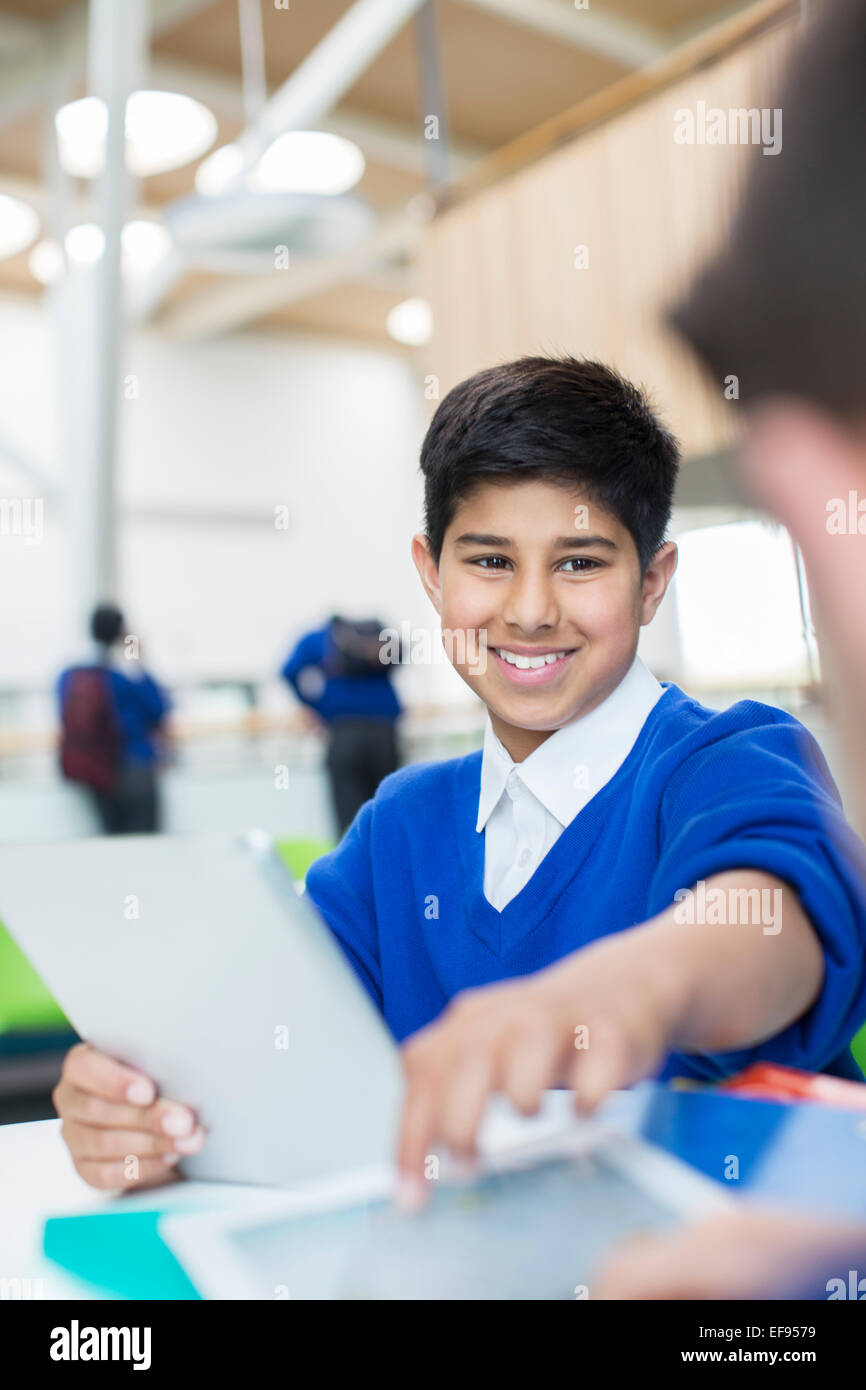 Elementary school boy with digital tablet - Stock Image