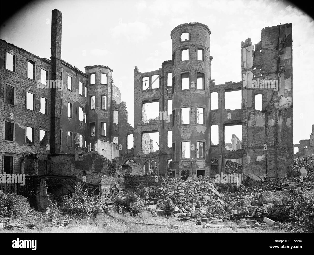 The photo by famous photographer Richard Peter sen. shows the ruins of the graphic buildings in the Lindenaustraße Stock Photo