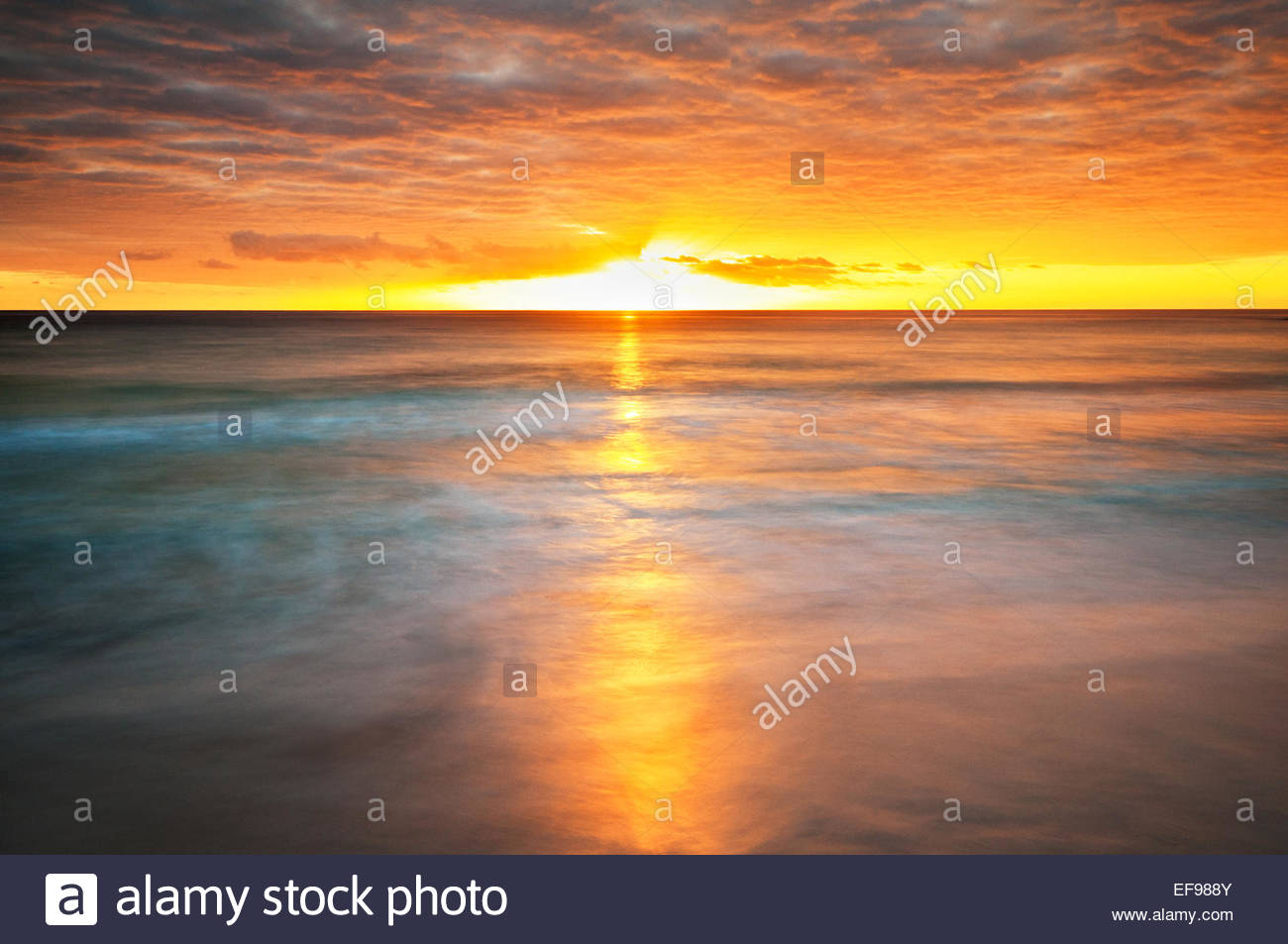 Sunrise over the ocean at Bay of Fires. - Stock Image