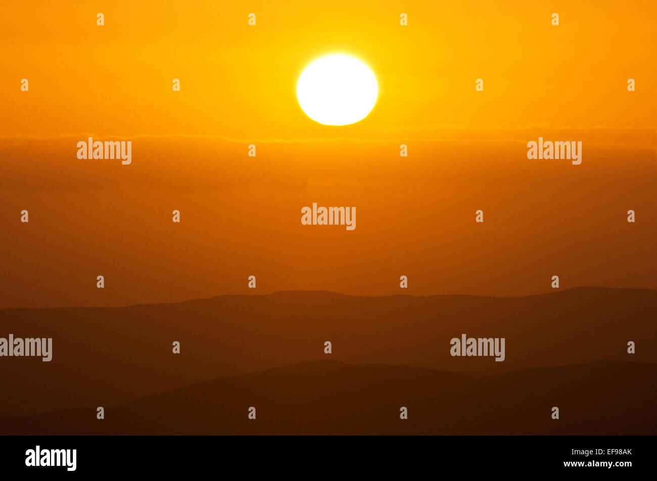 Sun in a colourful mood. - Stock Image