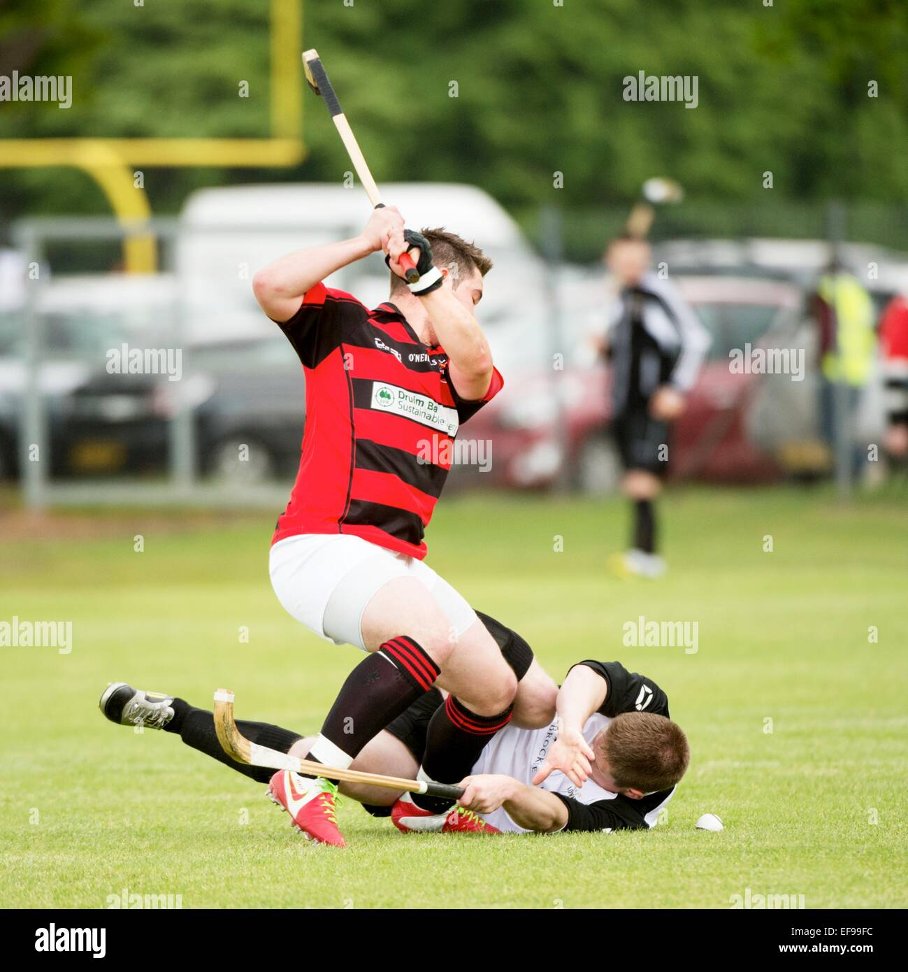 Fierce challenge during Lovat v Glenurquhart - Co-operative MacTavish Cup Final played at The Bught, Inverness, - Stock Image