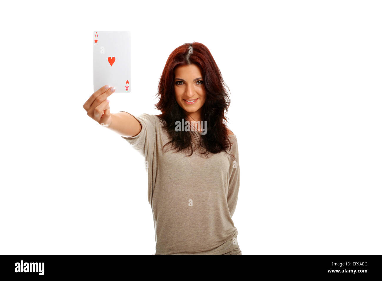 Beautiful brunette happy with the Ace of Hearts - Stock Image