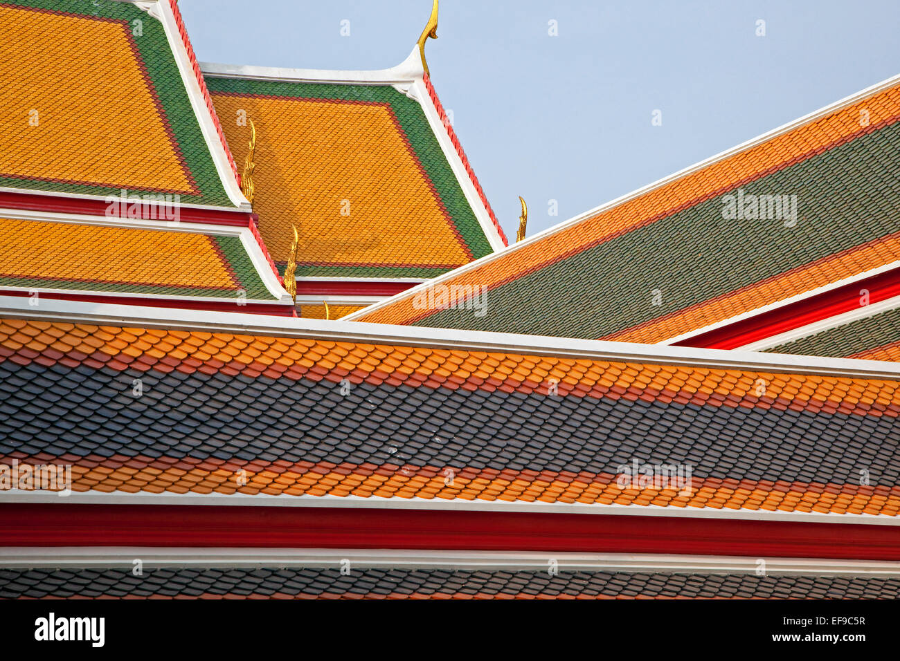 Colourful tiles on rooftops of the Wat Pho complex / Temple of the Reclining Buddha, Buddhist temple, Phra Nakhon, - Stock Image