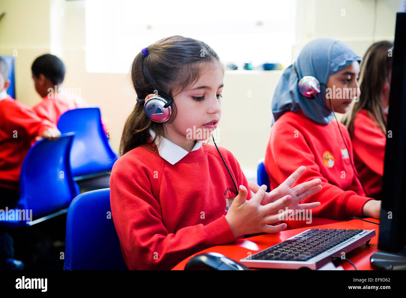 Girl in primary school doing an online maths test and using her ...