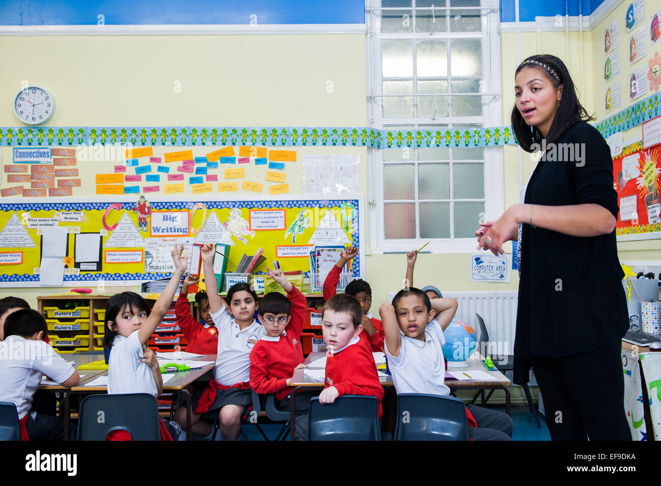 teacher with primary school children in class at primary school london uk