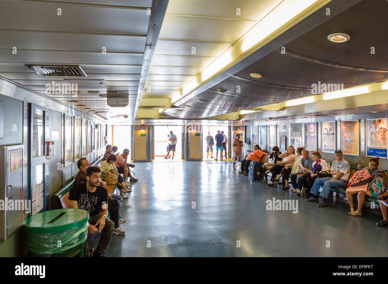 Passengers on board the Staten Island Ferry, New York City, NY, USA - Stock Image