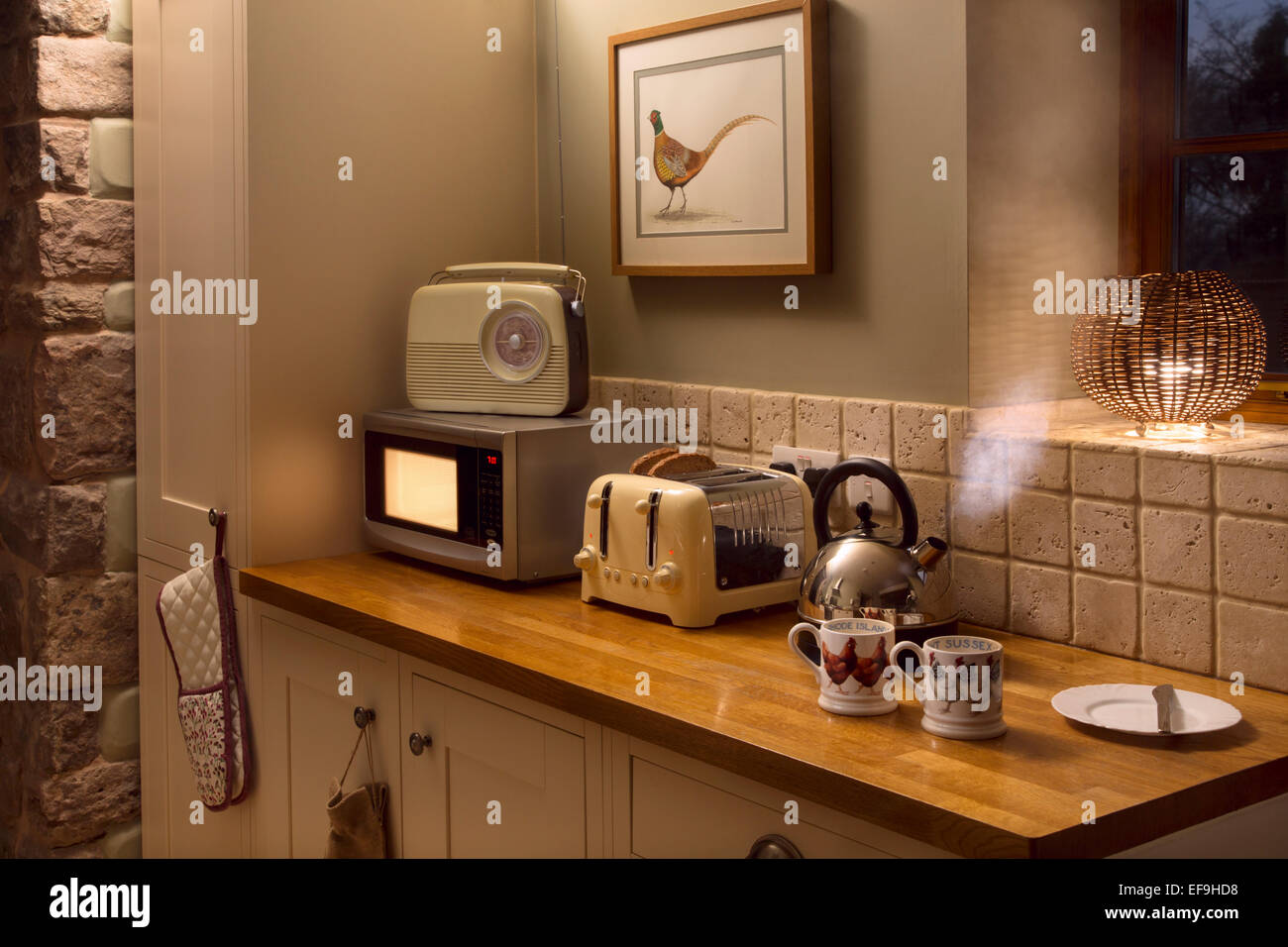 Electrical appliances in use in a kitchen. Stock Photo