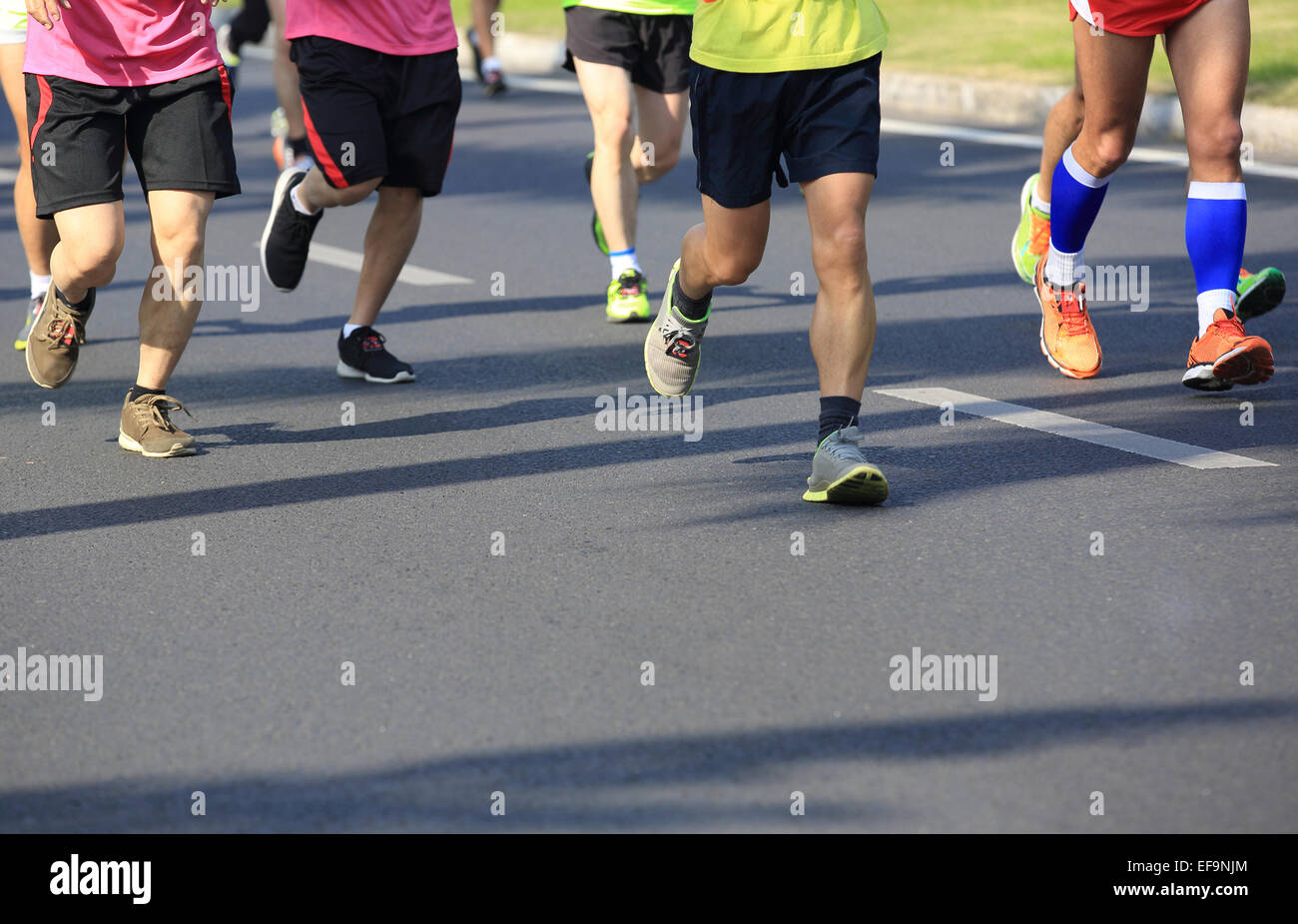 marathon runners runnning on city road - Stock Image