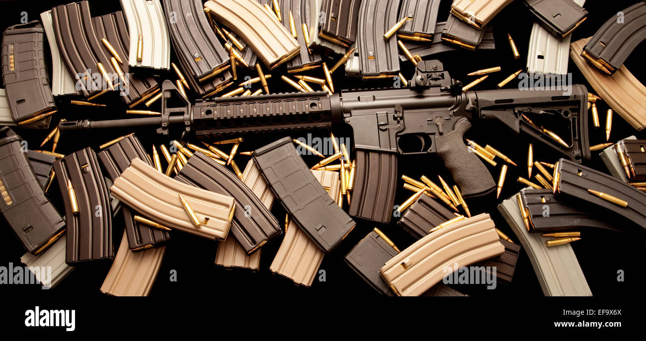 AR-15 assault rifle with high-capacity ammunition magazine clips and live ammo in caliber 5.56mm .223 - Stock Image