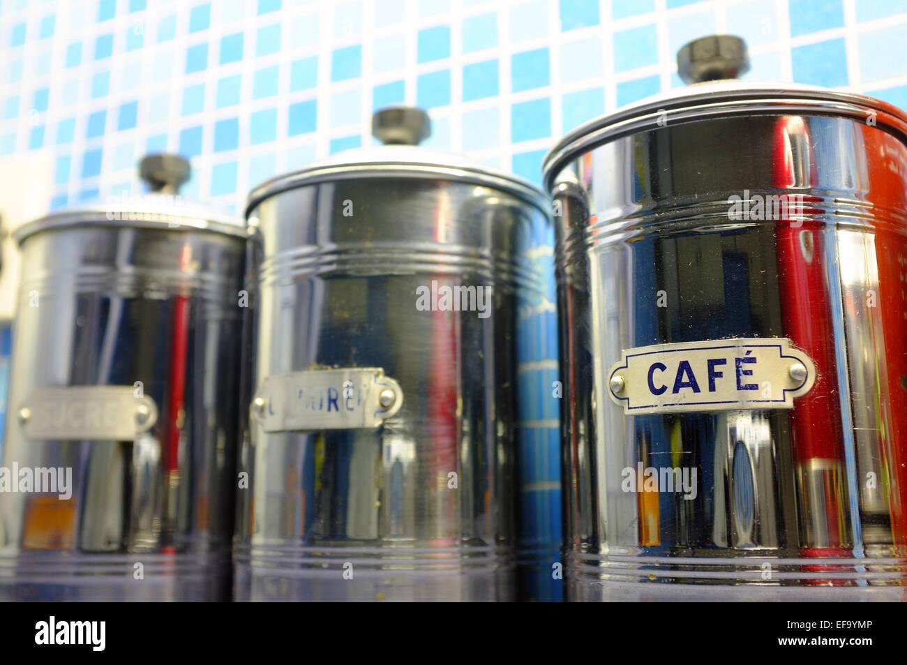 Stylish metal food storage tins on a kitchen counter. - Stock Image