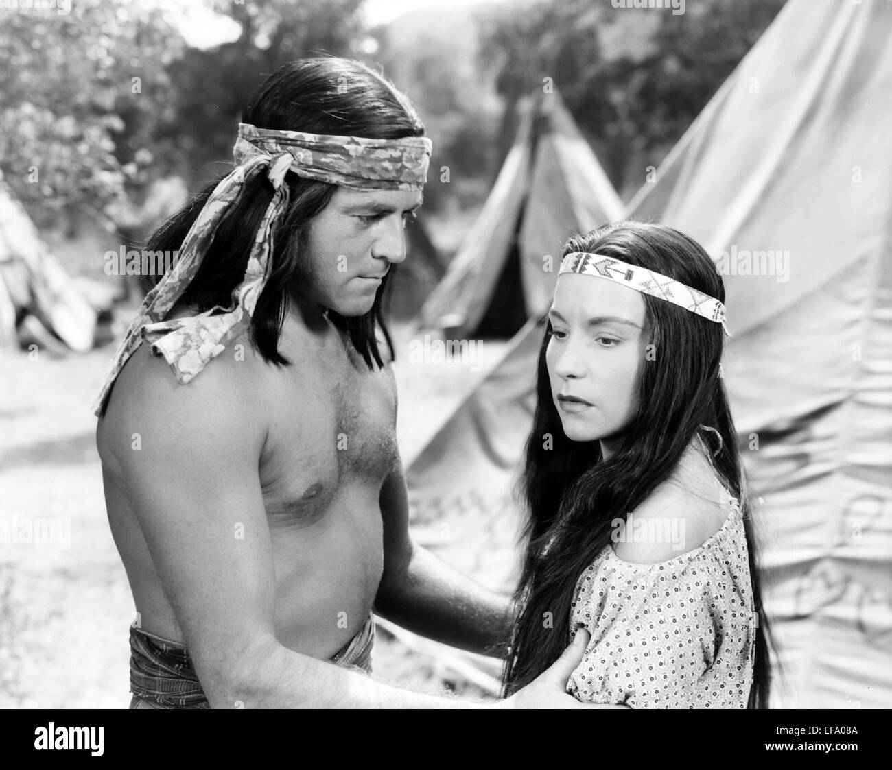 ALAN CURTIS, CAROL THURSTON, APACHE CHIEF, 1949 Stock Photo