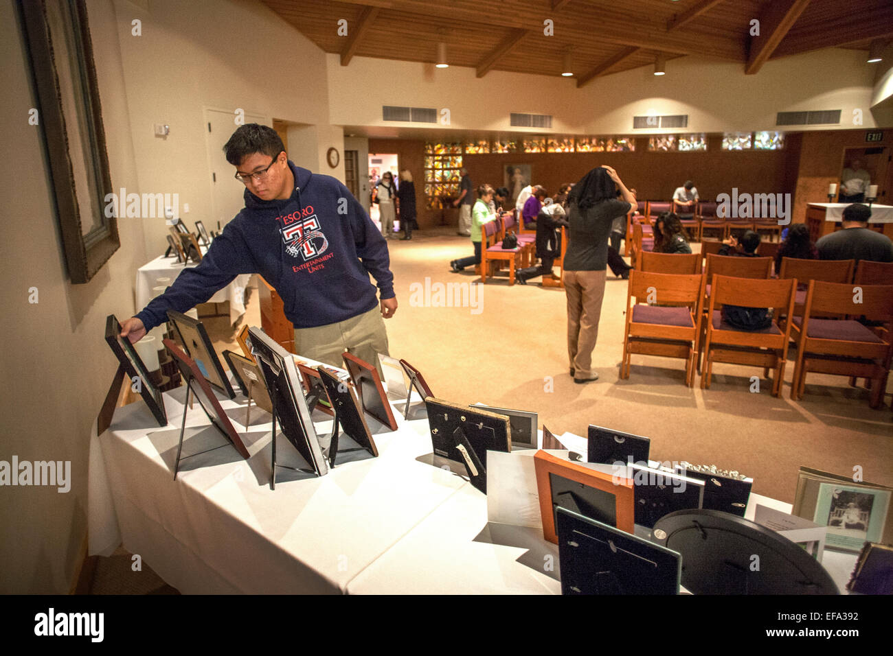 After an All Souls Day mass at St. Timothy's Catholic Church, Laguna Niguel, CA, an Asian American teenager looks Stock Photo