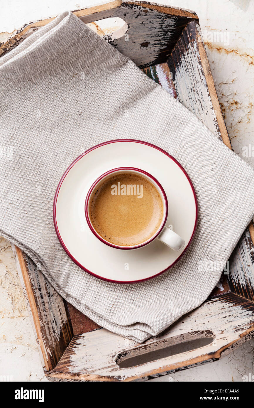 Coffee cup in Vintage tray on beige background - Stock Image
