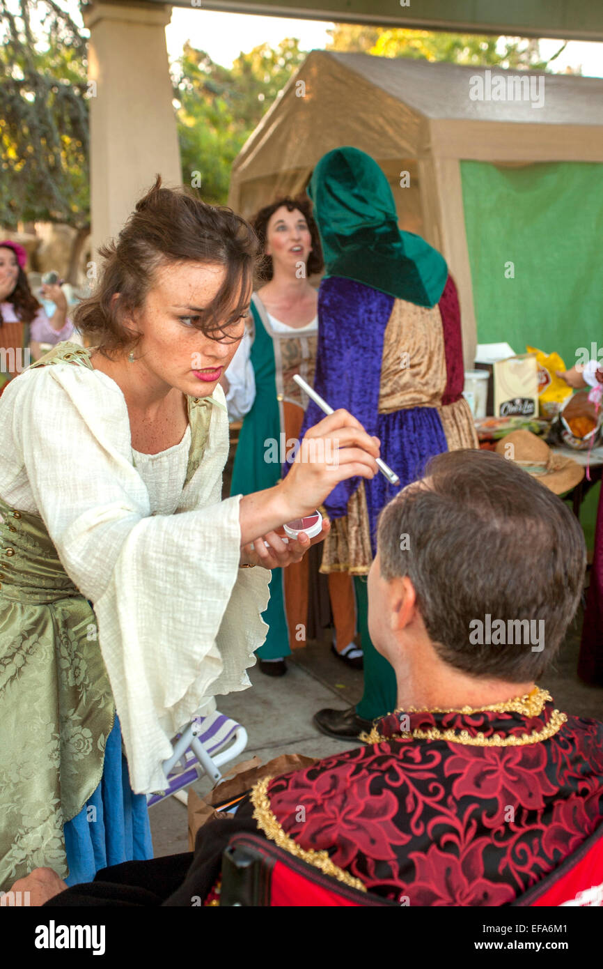 Two amateur Shakespearean actors don their makeup for an outdoor performance in Laguna Hills, CA. - Stock Image