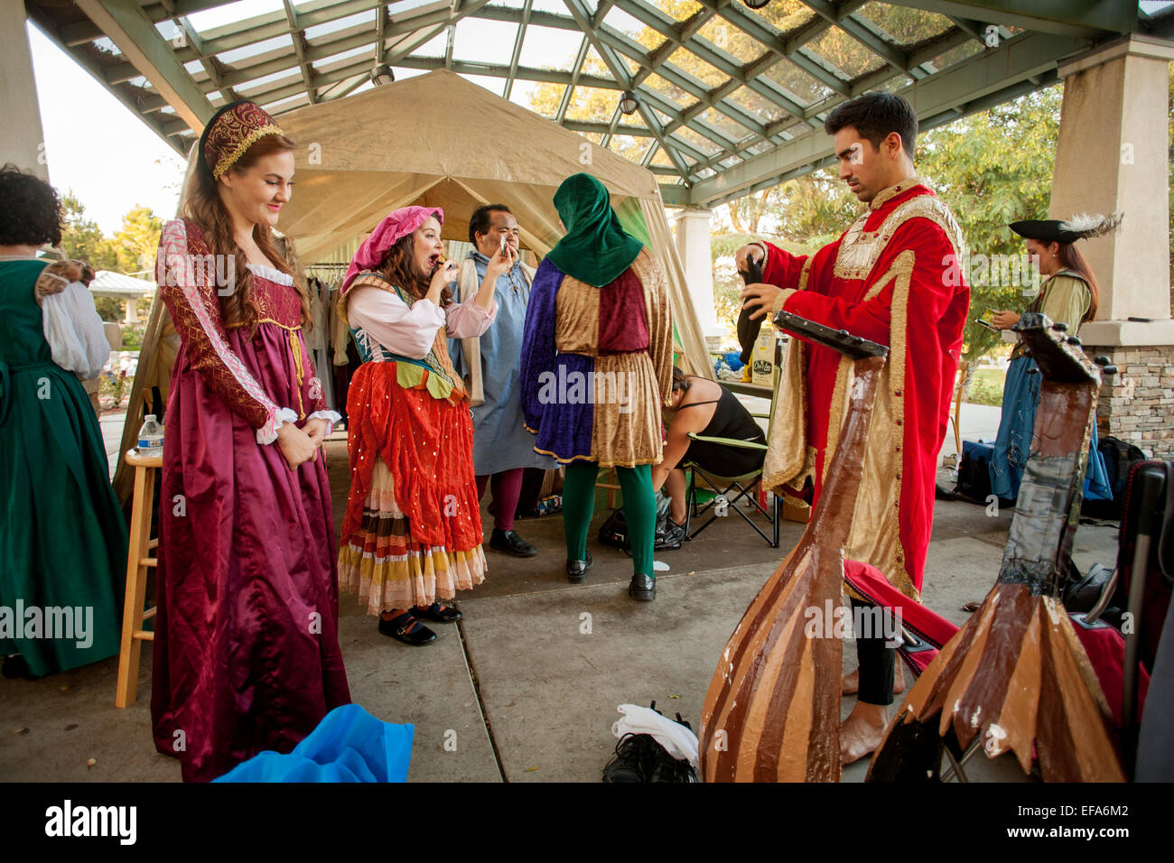 Amateur Shakespearean actors don their costumes for an outdoor performance in Laguna Hills, CA. - Stock Image