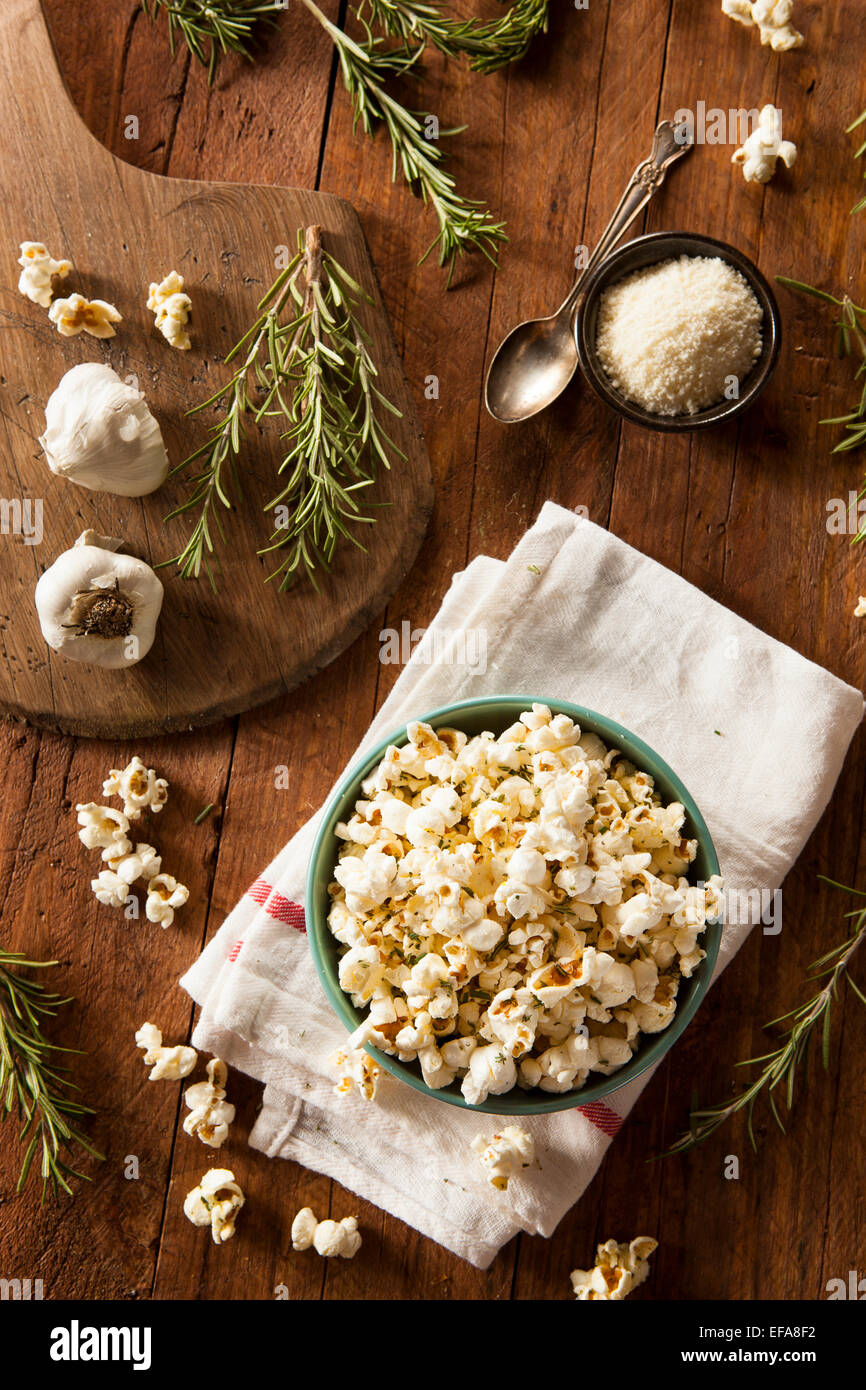 Homemade Rosemary Herb and Cheese Popcorn in a Bowl - Stock Image