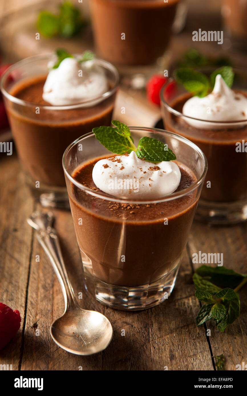 Homemade Dark Chocolate Mousse with Whipped Cream - Stock Image