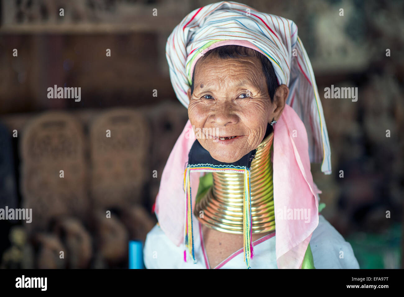Portrait of a long neck Kayan woman. Brass coils creating long necks is a tradition of the Kayan Lahwi women. Stock Photo
