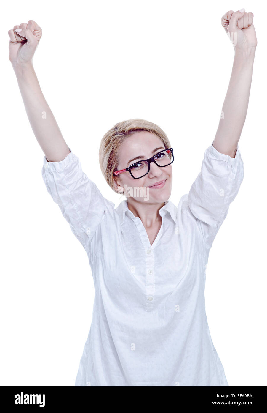 Cheerful woman celebrating on the white background - Stock Image