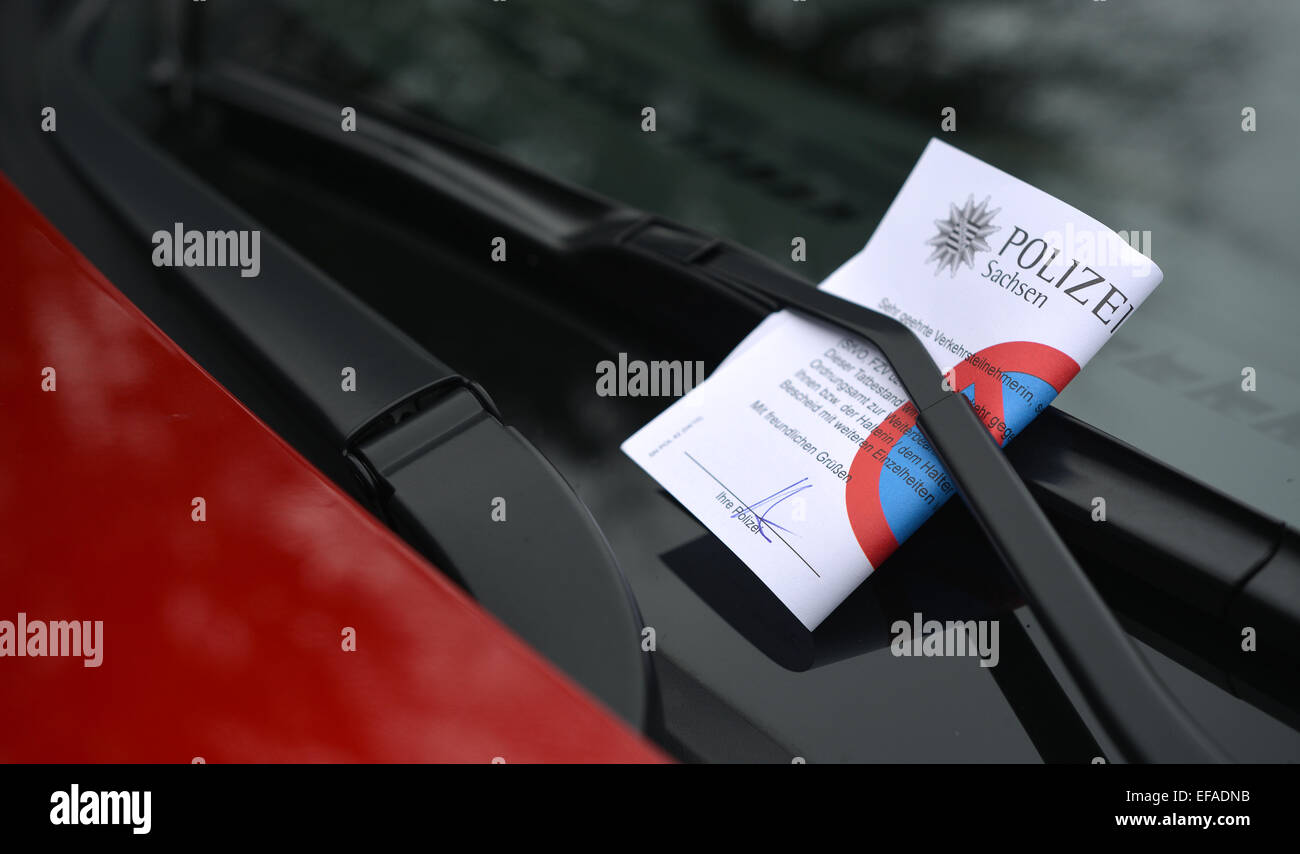 Illegally parked car with a parking ticket under thewindscreen wiper, from the Police of Saxony, Chemnitz, Saxony, - Stock Image