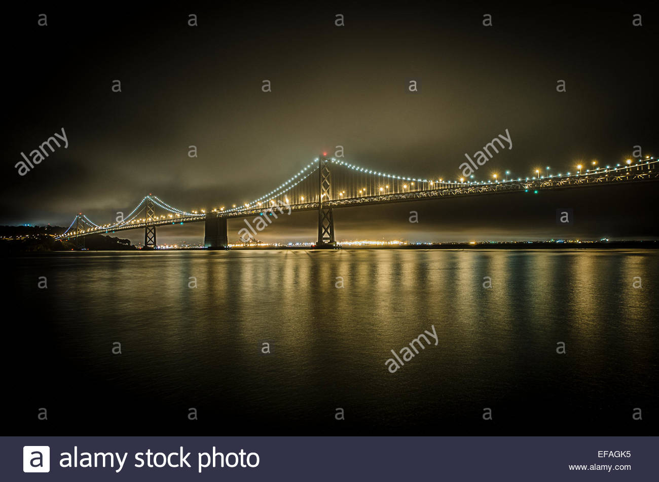 View of San Francisco Bay Bridge at night - Stock Image