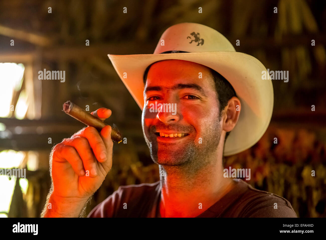 Tobacco farmer Luis Manne Alvares Rodrigues smoking a Havana cigar, tobacco farm, Vinales Valley, Vinales - Stock Image