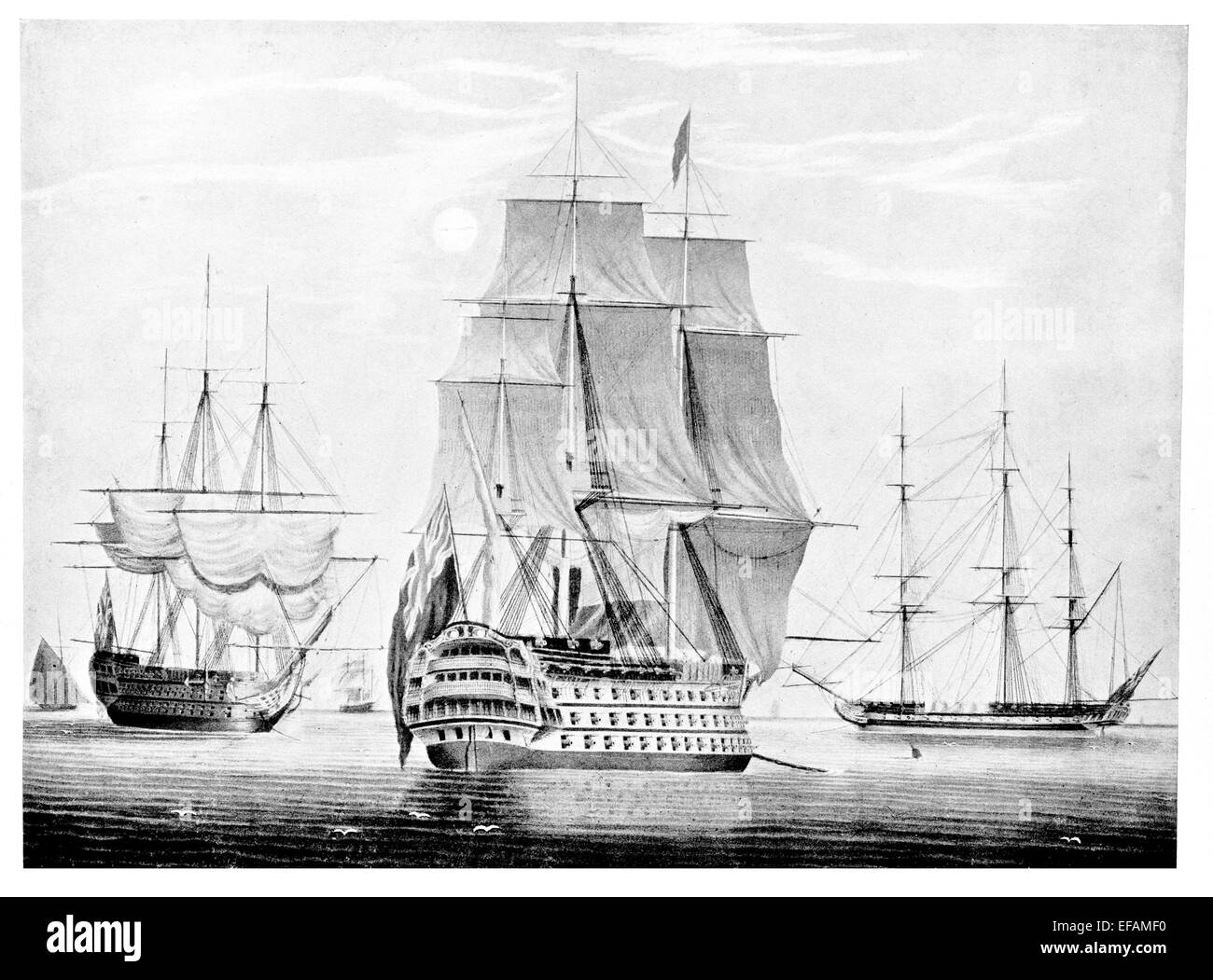 Ships at Anchor 1815 left to right a Cutter under sail. A line of Battle ship under sail and a large Frigate. - Stock Image