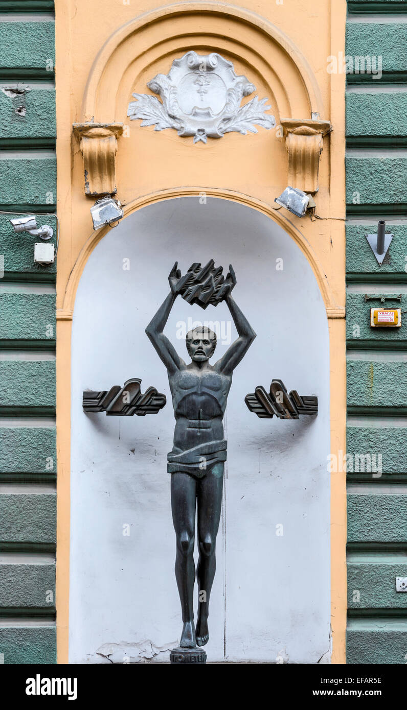 Prometheus sculpture at building, early 20th century, Holovna Street, Chernivtsi, Bukovina Region, Ukraine - Stock Image