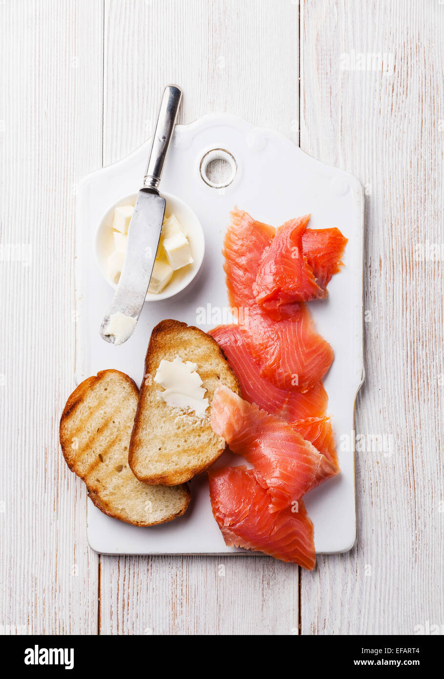 Salted smoked red fish and grilled slices of bread for breakfast - Stock Image