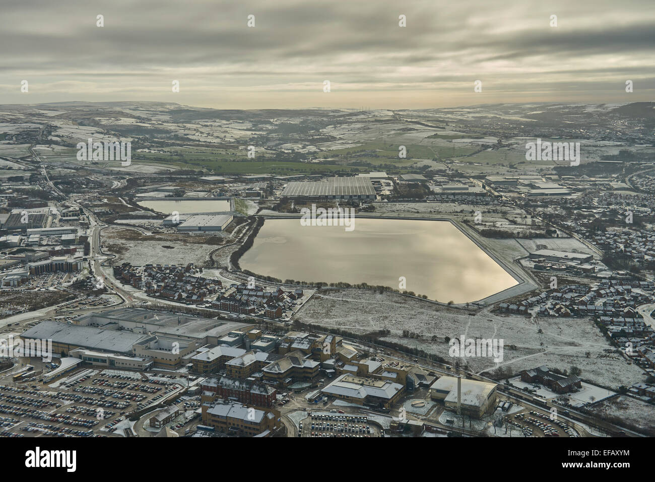 A winter aerial view from the southern edge of Blackburn over the Fishmoor Reservoir to the countryside beyond - Stock Image