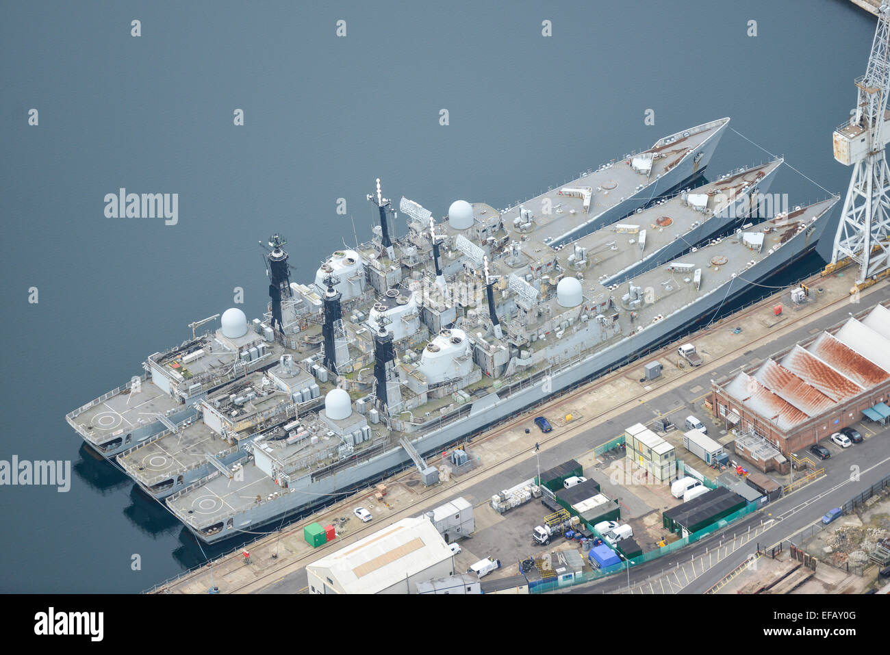 An aerial view of Royal Navy warships berthed at HMNB Portsmouth - Stock Image