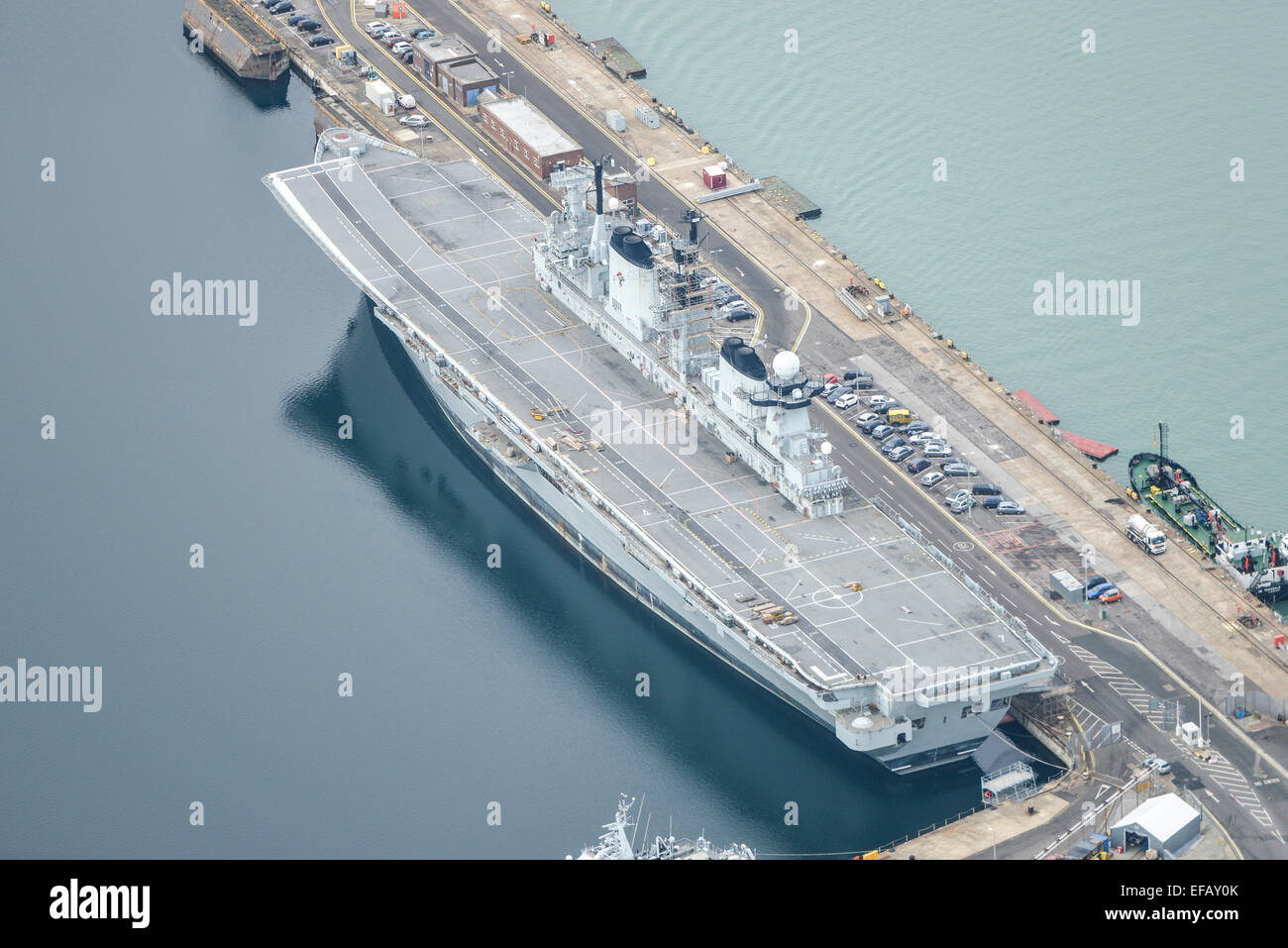 An aerial view of HMS Illustrious, a decommissioned Invincible Class Aircraft Carrier of the Royal Navy berthed - Stock Image