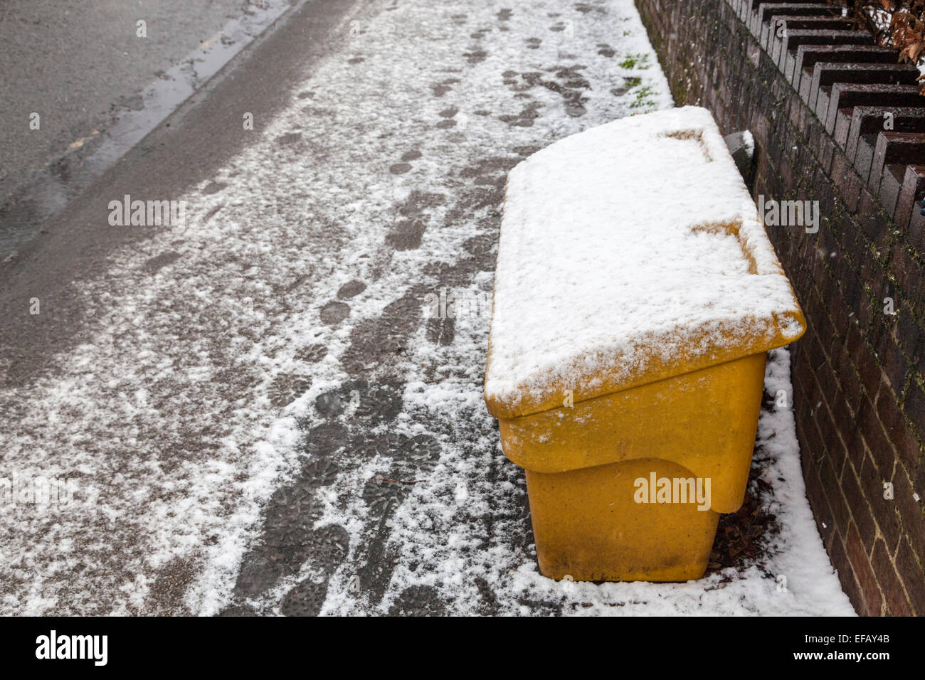 Roadside grit bin or box in snow, Nottinghamshire, England, UK - Stock Image