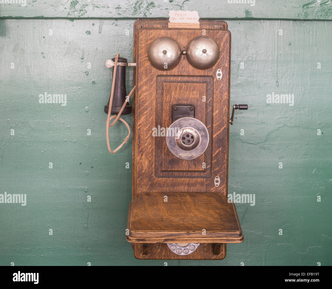 Old telephone with crank in the Museum City, South Pass City, Wyoming, United States Stock Photo