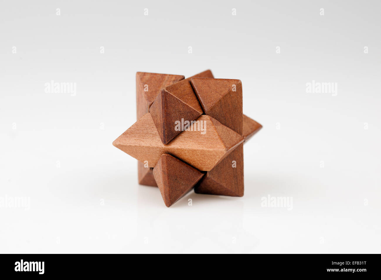 Wood puzzle in the shape of a star - Stock Image