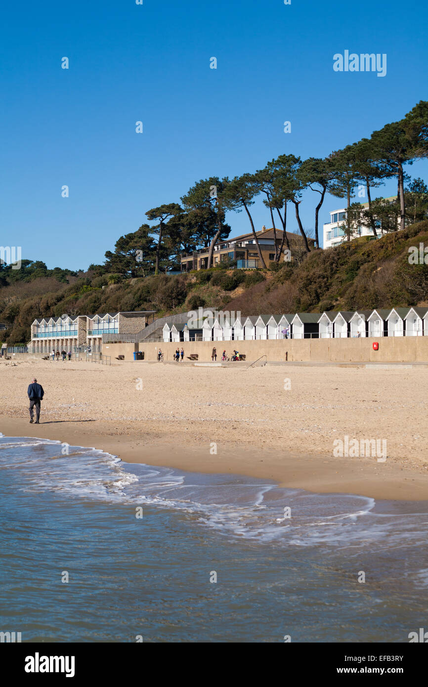 beach and beach huts at Branksome Dene Chine, Poole in March Stock Photo