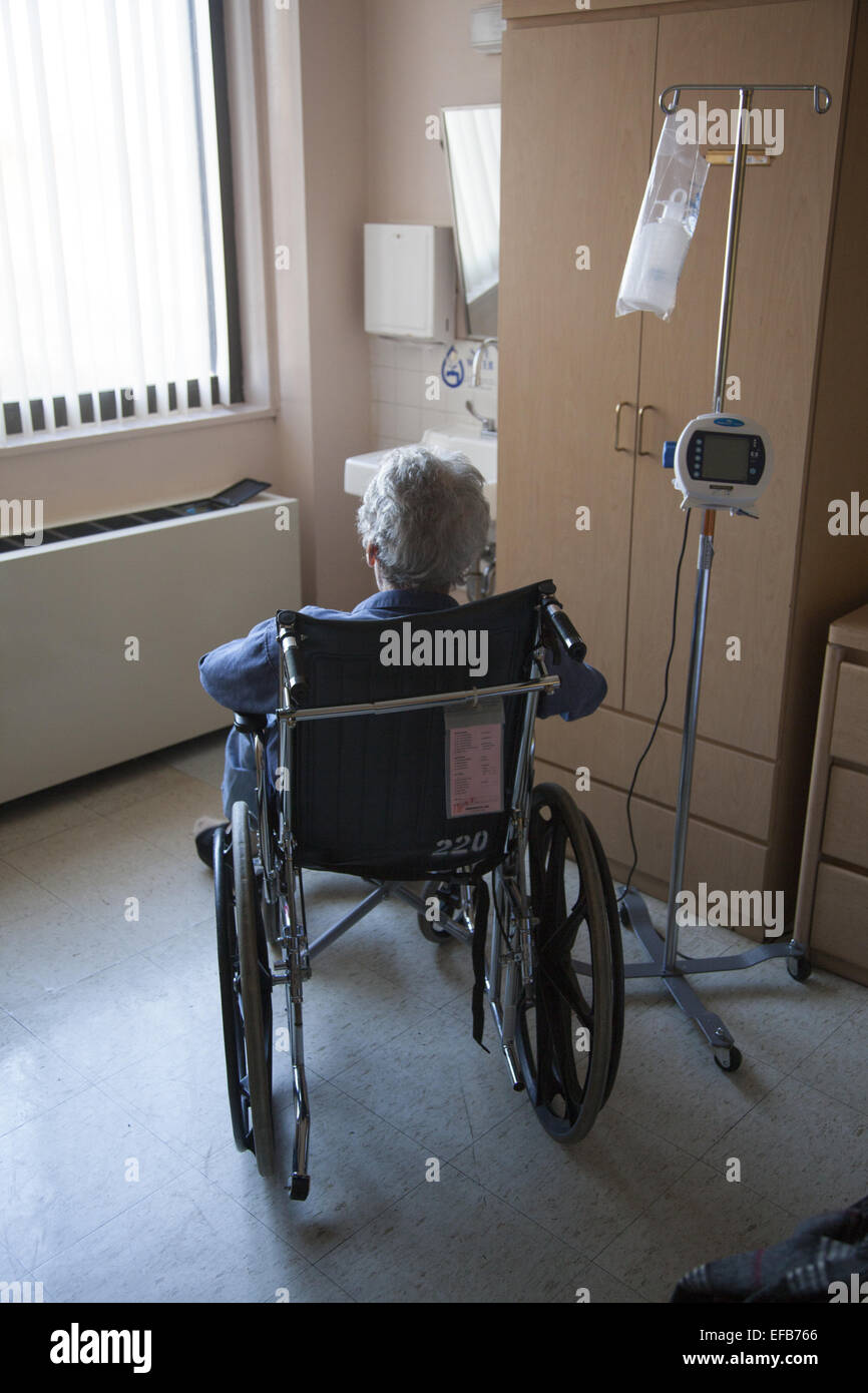 Dementia: Man sits alone in his room surrounded by his own