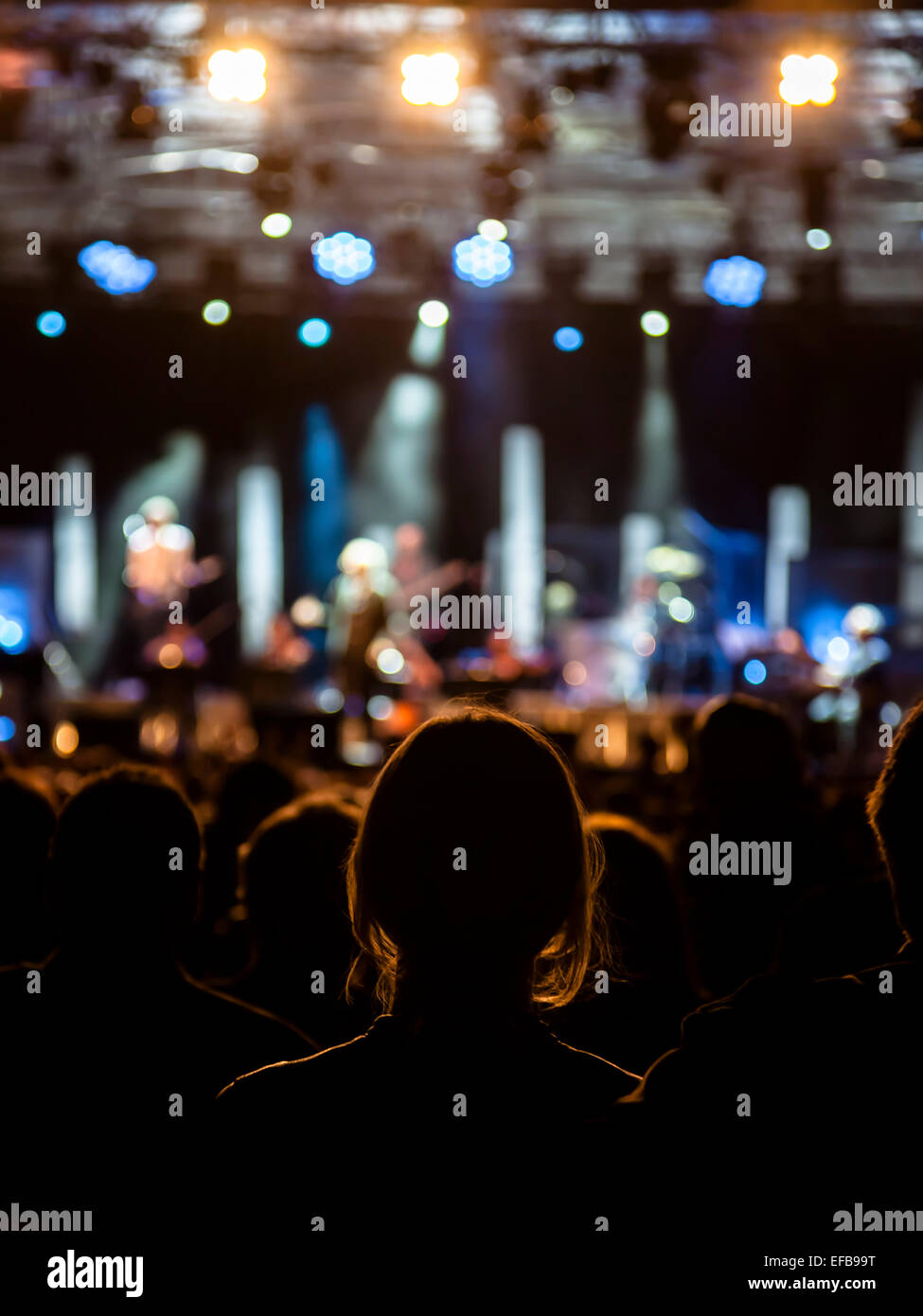 Girl fan listening to a rock open air-live concert, Monza, Italy - Stock Image