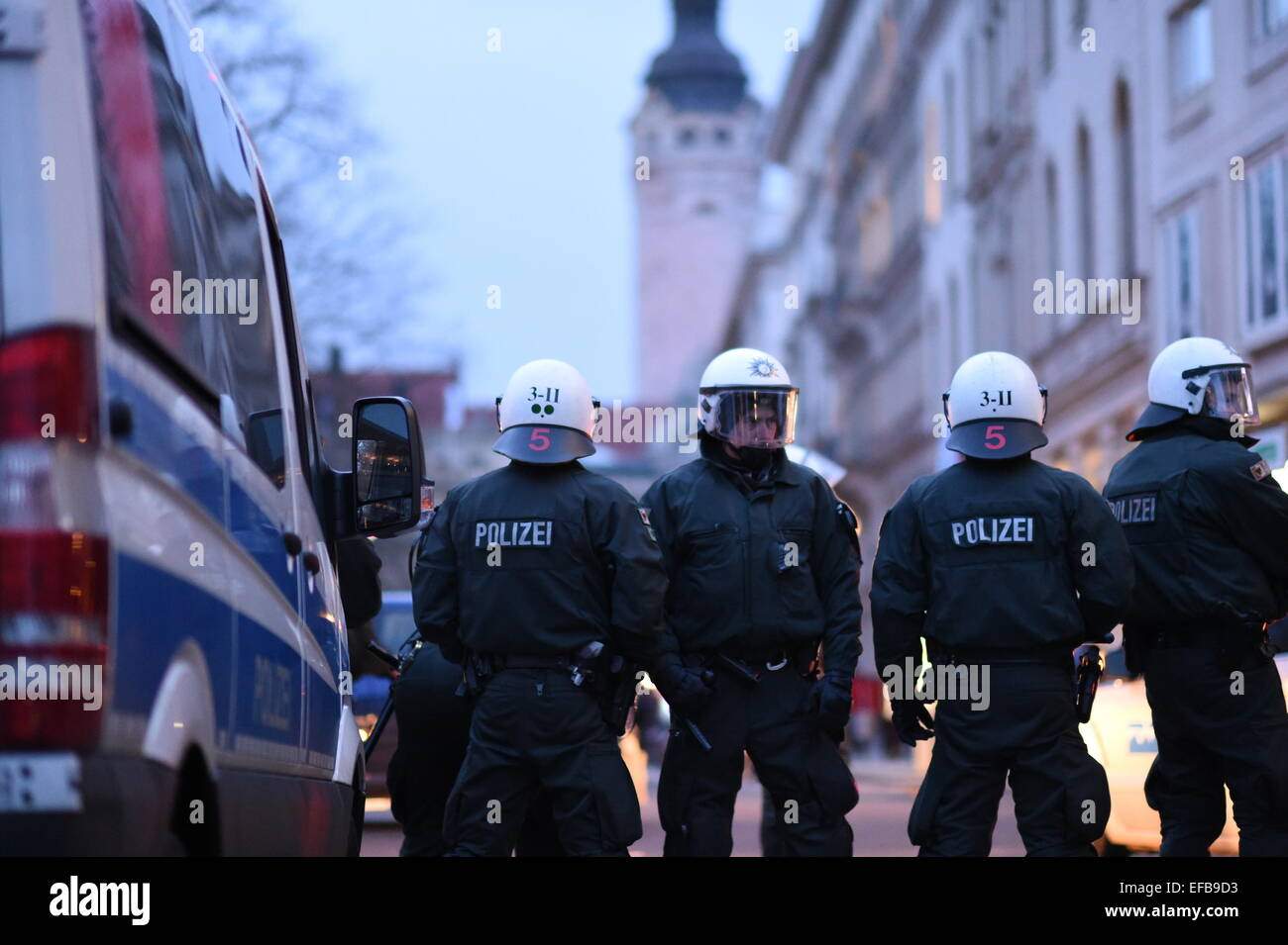Leipzig, Germany. 30th Jan, 2015. Police men surveil a demonstration against the islam critical movement 'Legida' - Stock Image