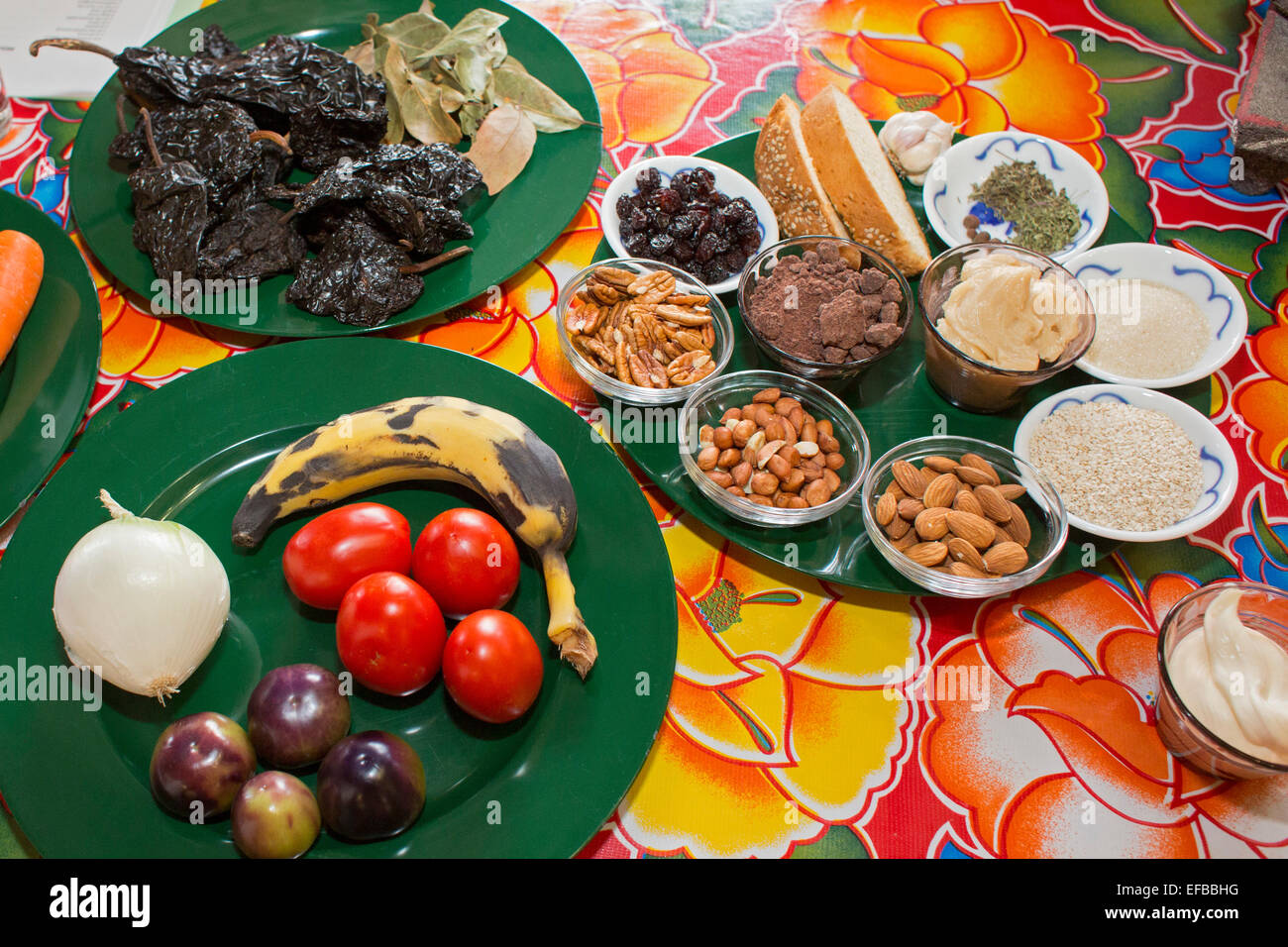 Oaxaca, Mexico - Ingredients for mole negro, displayed at a cooking class for American tourists. - Stock Image